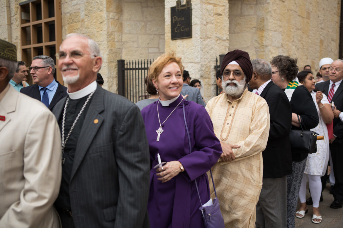 Interfaith leaders enter Main Plaza before leading reflections.