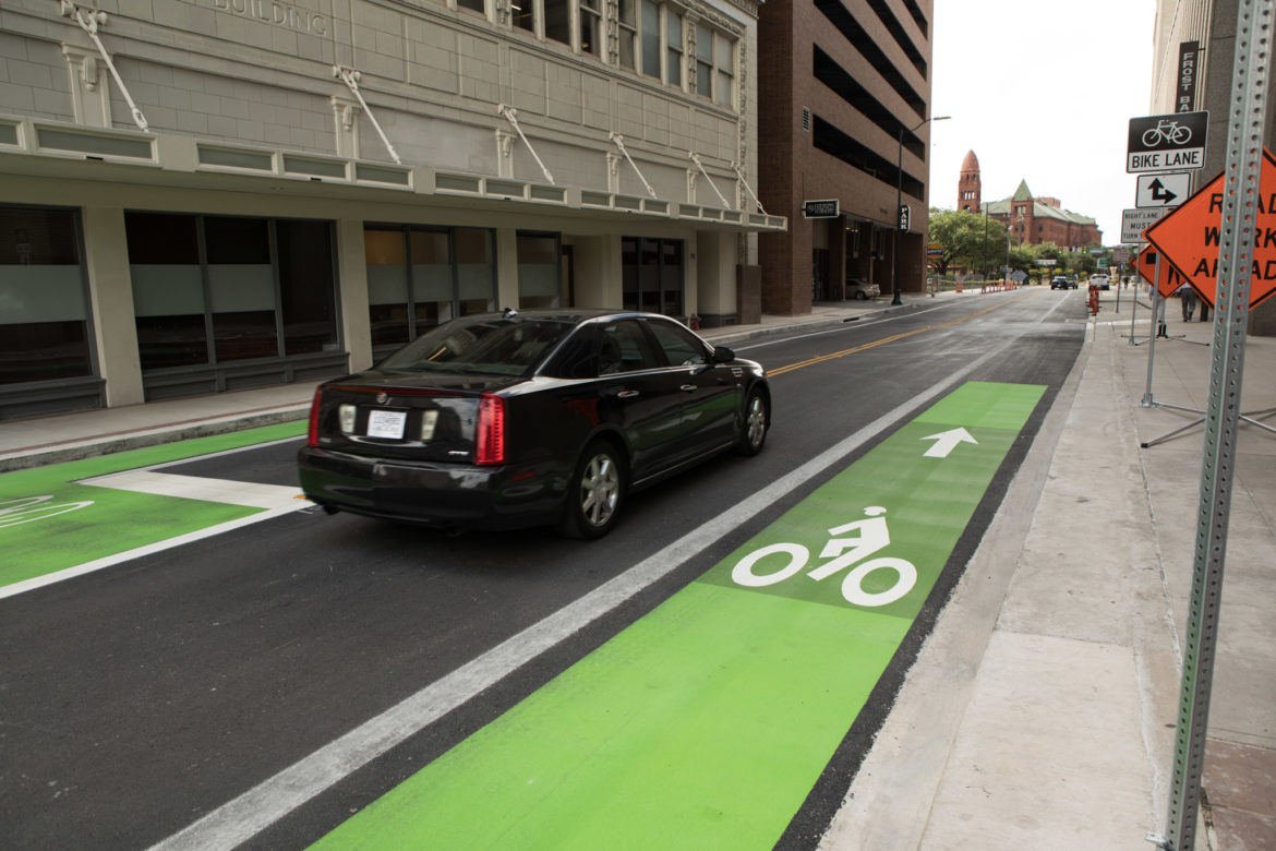 Bike lanes are painted green at the intersection of Main Street and Houston Street downtown.