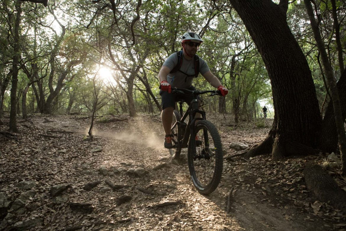 A mountain biker drops into the Leon Creek Greenway from OP Schnabel Park.