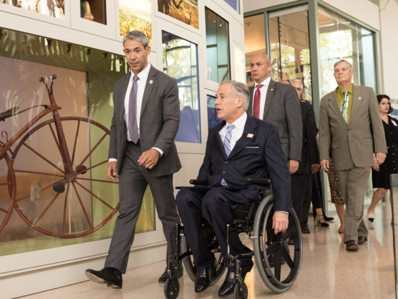 (From left) Mayor Ron Nirenberg and Governor Greg Abbott walk into the Wittee Museum for the announcement.