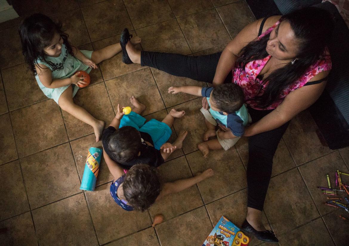 Promotora Beverly Chavez (right) plays with (clockwise, from top left) Sofia, Julian, Leilah, and Jordan.