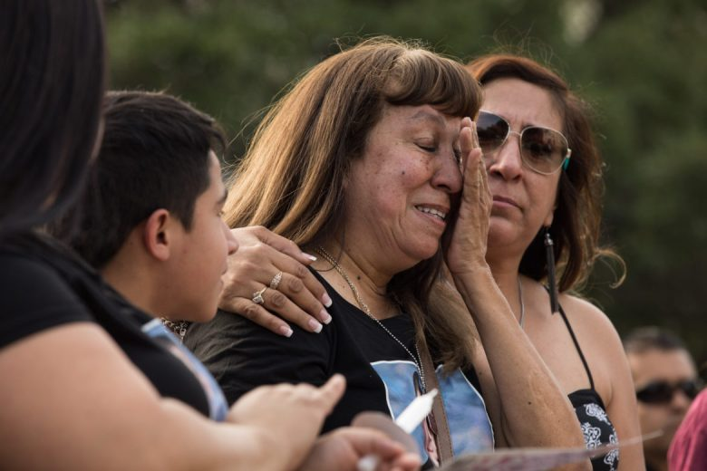Linda Martinez Guel, Scott Deem's mother-in-law, (center) is comforted by her family as she sheds tears in memory of Scott.