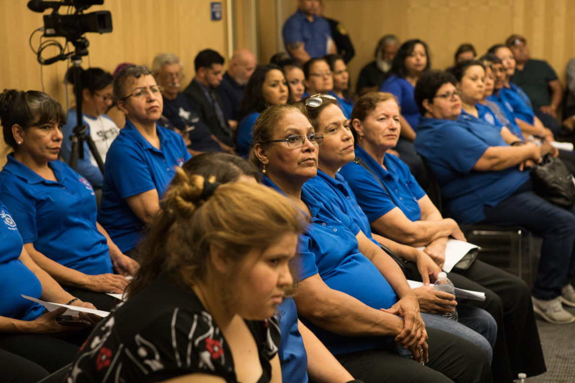 Members of the district's child nutrition department and officers from South San's police department attended the meeting in the hopes of convincing trustees that cuts to their departments were unnecessary and a bad idea.