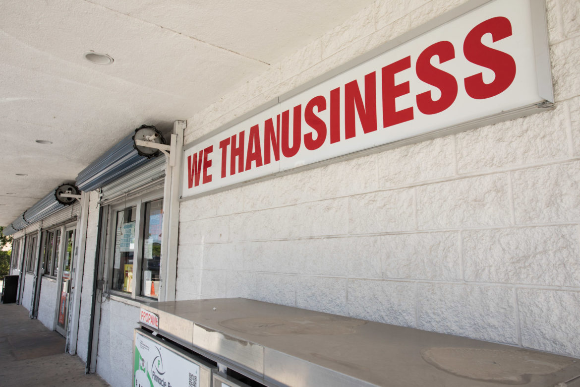 "Molina's San Antonio Country Store, located at 700 N. Alamo St. next to Shell, displays a sign reading ""WE THANUSINESS."""