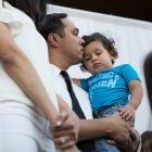 Congressman Joaquin Castro (TX-20) kisses his son Roman Victor Castro on the head.