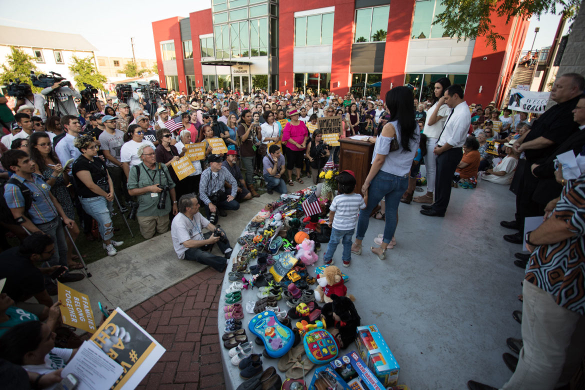"""Hundreds gather for the """"Where are the Children"""" rally at Guadalupe Plaza."""