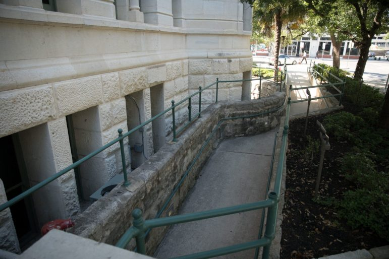 The wheelchair accessible ramp located on the back, or west, side of City Hall.