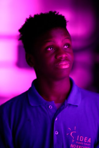 David Jones, eighth-grade student, stands inside the hydroponic shipping container at IDEA Public Schools' Eastside campus.