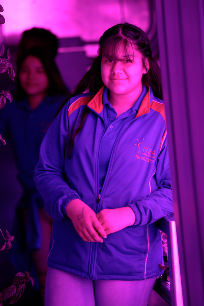 Briana Perez, an eighth-grade student at IDEA Public Schools' Eastside campus, tours the hydroponic shipping container with her classmates.