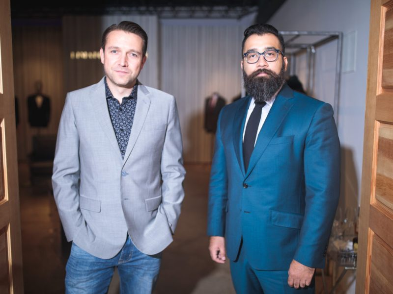 Devin Castleton (left) and James Castro of Limatus Bespoke stand at the entry way of their business.