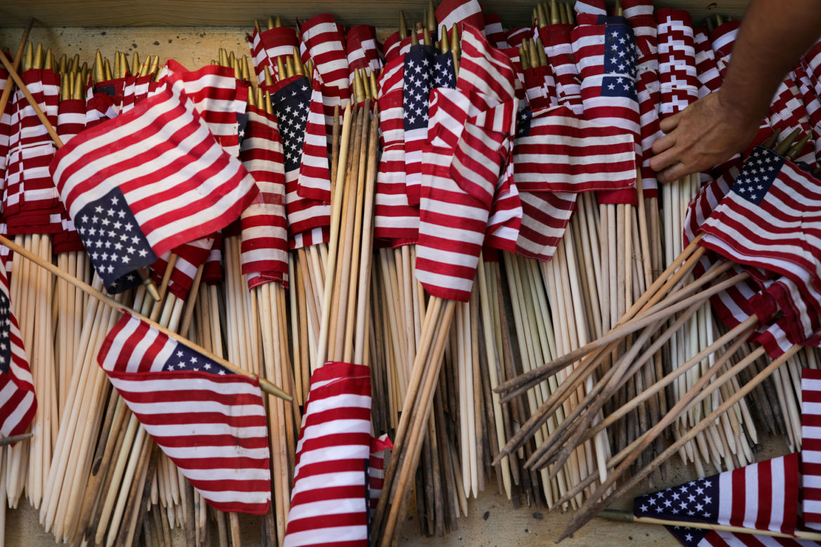 American Flags are bundled in a large box at Fort Sam National Cemetery.