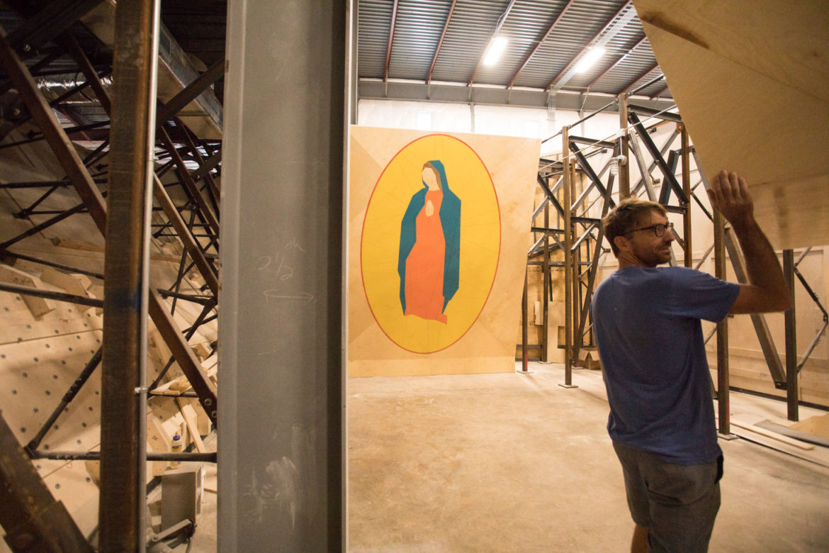 Joe Kreidel, Armadillo Boulders co-owner, walks into the Grotto, a training area where one wall bears a roughly 13-foot-tall outline of the Virgin of Guadalupe.