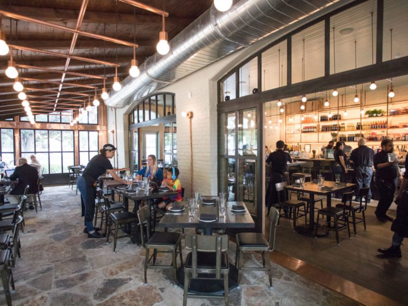 Inside Dough Pizzeria Napoletana at Hemisfair, customers can sit on a patio overlooking Yanaguana Garden.