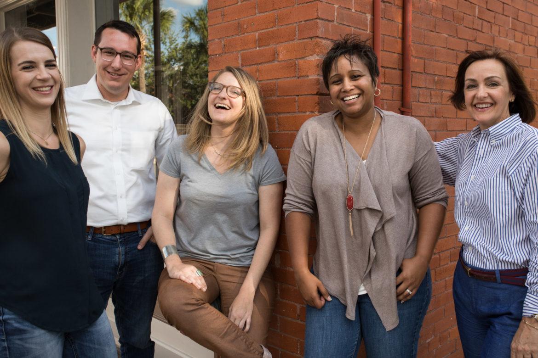 (from left): Hanna Oberhofer, community and production editor; Scott Ball, photo editor; iris Dimmick, senior reporter; Graham Watson-Ringo, managing editor; Wendy Lane Cook, deputy managing editor.