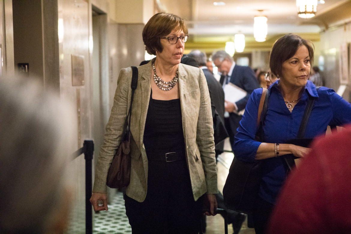 (From left) Martha Owen and Shelley Potter wait at the elevator to go to the fourth floor.