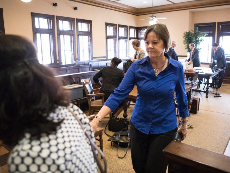 Shelley Potter walks out of Karen Pozza's courtroom for a quick break.