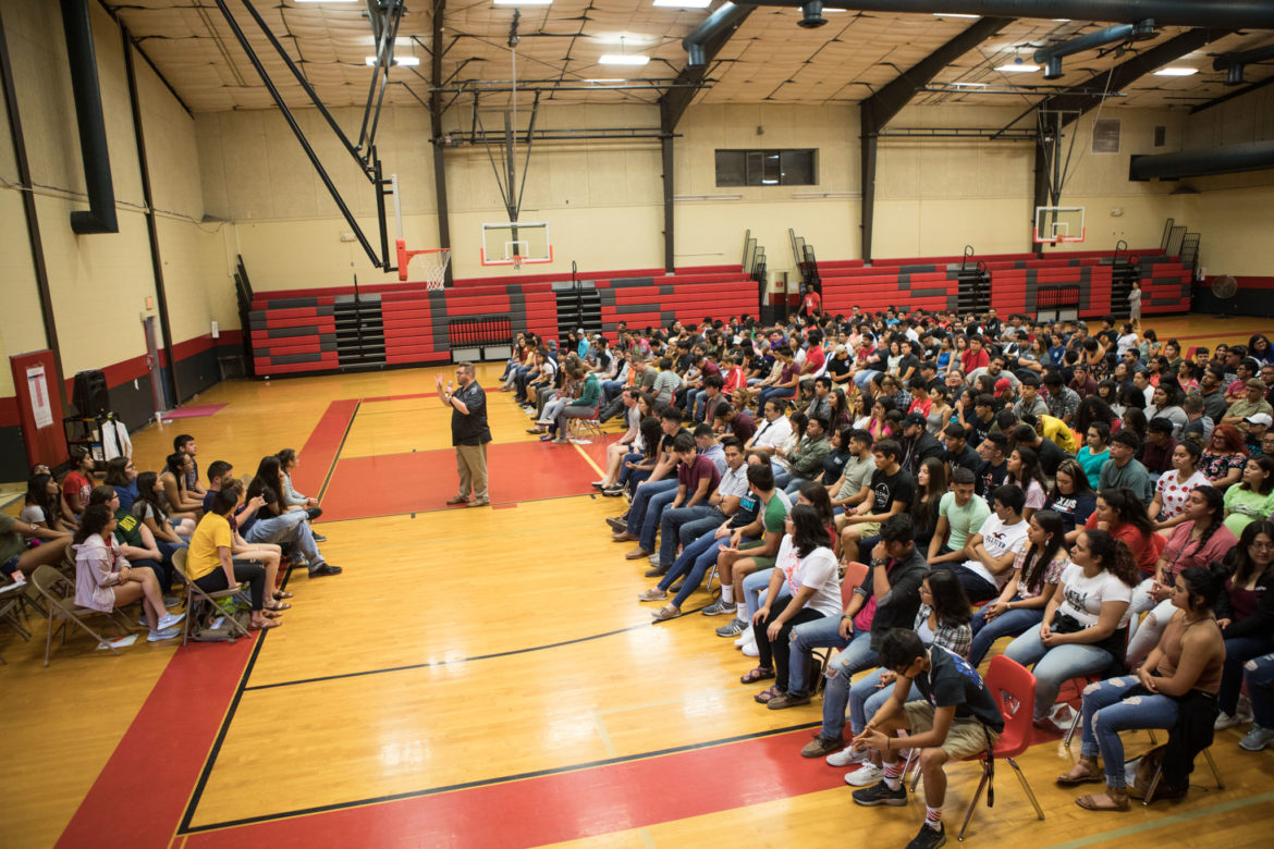 Southside High School students sit in their assigned seats while practicing for their graduation ceremony.