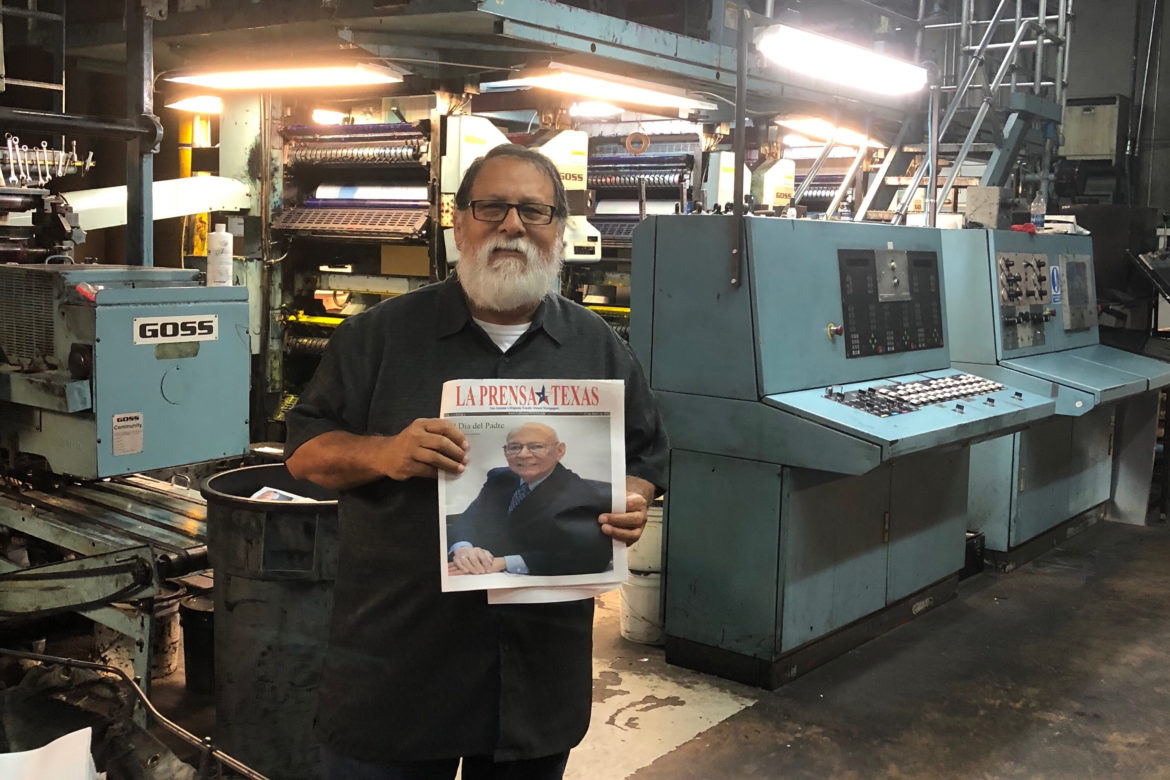 Steve Duran holds a copy of La Prensa Texas, which was relaunched on Sunday after it announced its closure last week.