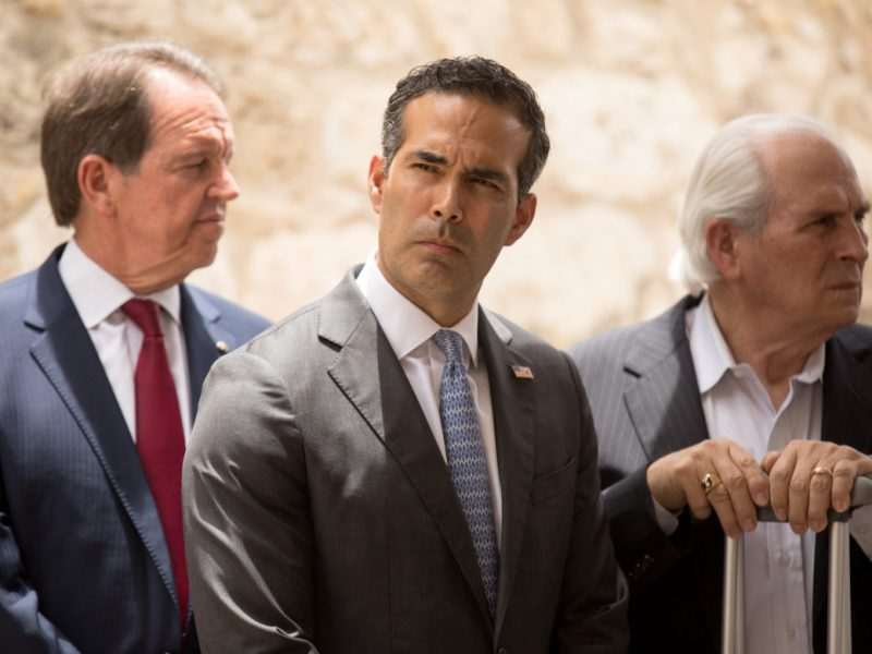 "Texas Land Commissioner George P. Bush on Thursday defended a plan to relocate the Alamo Cenotaph because the 1930s monument is ""falling apart before our very eyes."""
