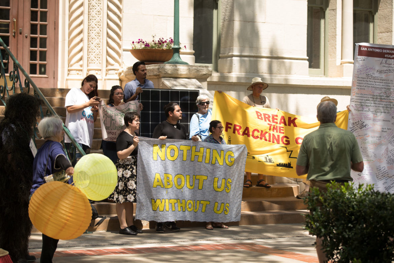 Climate Action SA activists hold a press conference demanding environment protections at City Hall.