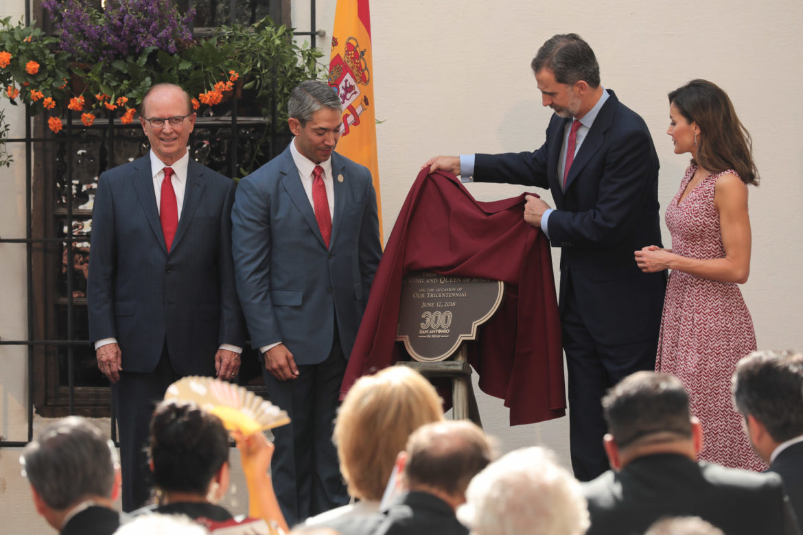 King of Spain Felipe VI unveils a commemorative plaque honoring the arrival of the royalty to San Antonio during the tricentennial.