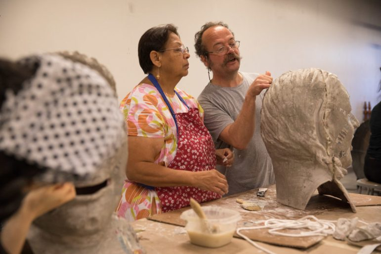 Visiting Spanish artist David Ventura works with Joanne Diaz on her project.