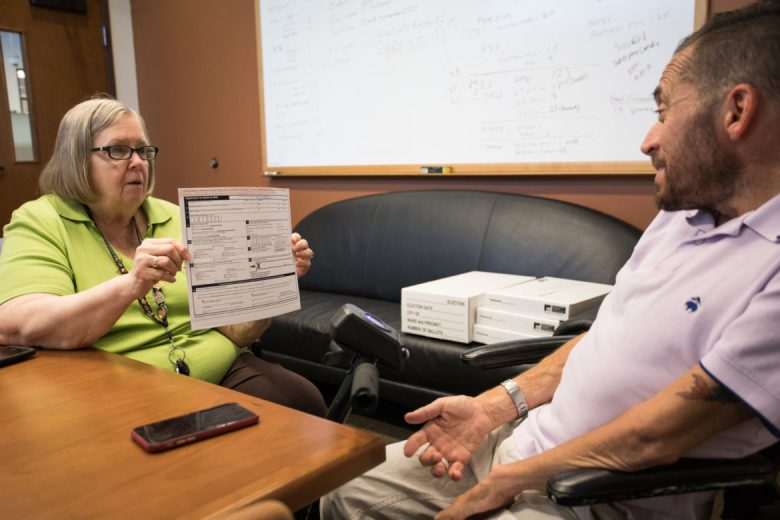 (From left) Jacquelyn Callanen, Bexar County Elections Administrator, speaks with Adam Flores-Boffa about optimizing registration, voting, and certification processes related to any election happening in Bexar County.