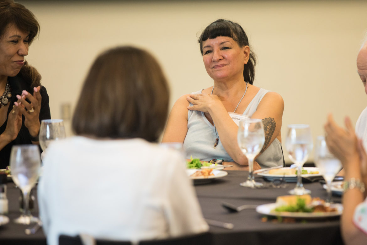 Author Sandra Cisneros is introduced at the dinner.