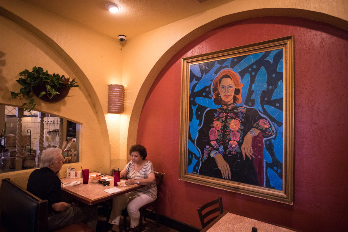 A painting of Viola Barrios is displayed in the dining room of Los Barrios.