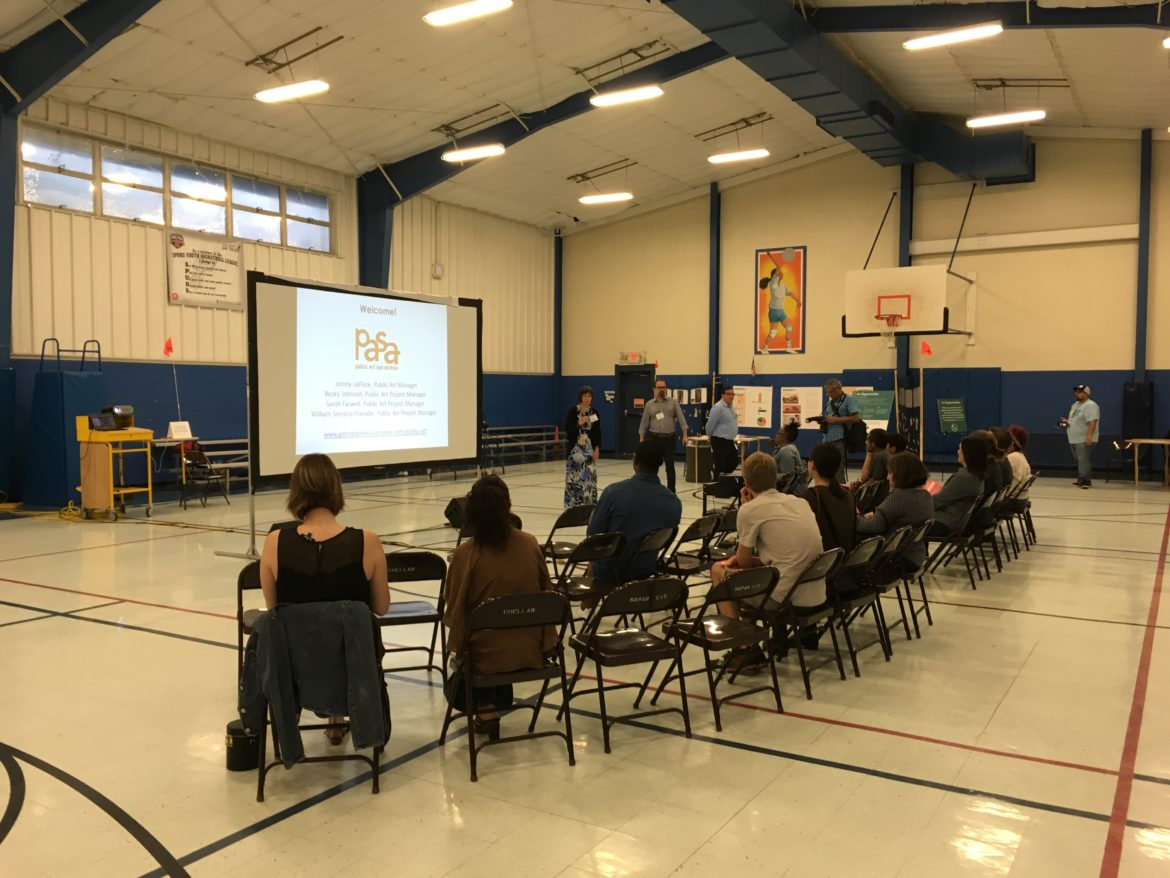 The first public informational ¿que pasa, PASA? meeting took place July 9 at the Cuellar Community Center's athletic gym, with City representatives showing examples of public art in San Antonio.