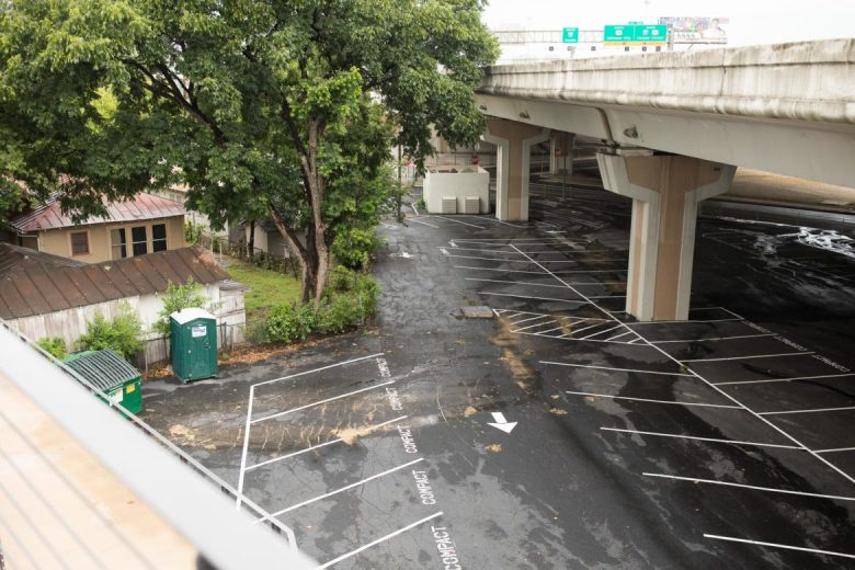 Recently acquired parking underneath Interstate 35 will be available for Midtown Station guests.