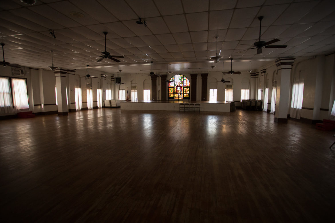 In the ballroom, stained glass windows date back to a 1937 addition.
