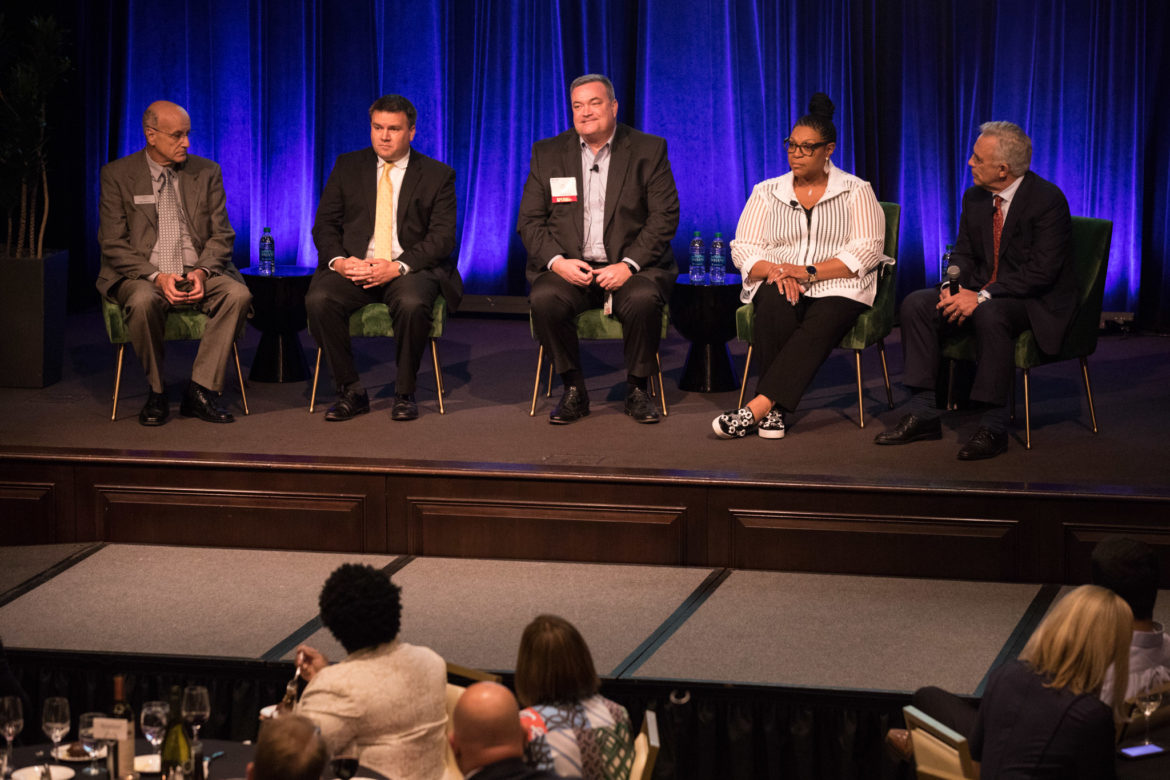 (From left) Bert Pfiester, Mark Muir, Eric Epley, and Tommye Austin speak to moderator Robert Rivard about their experience during the shooting at Sutherland Springs.
