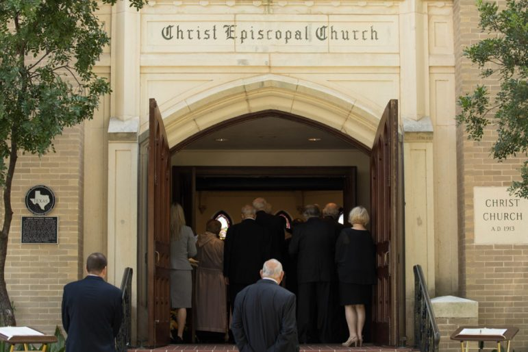 The crowd overflows outside the front door of the church before the ceremony.