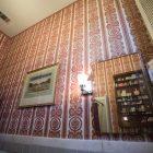 The wallpaper in the second-floor bathroom in Villa Finale: Museum & Gardens.