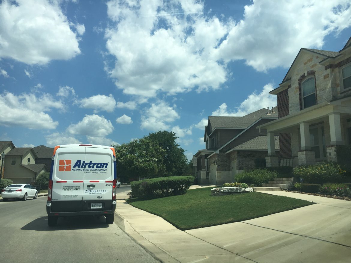 An air conditioning service vehicle sits outside a home in Northside San Antonio.