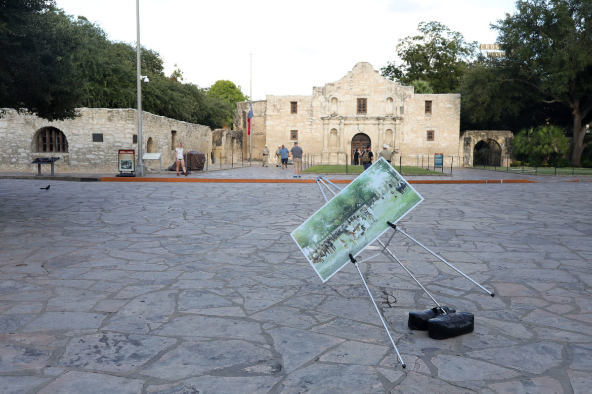 A design rendering of the now-scrapped Alamo Plaza plan teeters in front of the historic site in 2018.