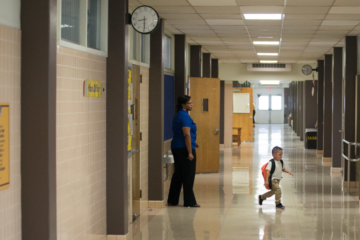 A student runs through the hallways of Democracy Prep at Stewart Elementary.
