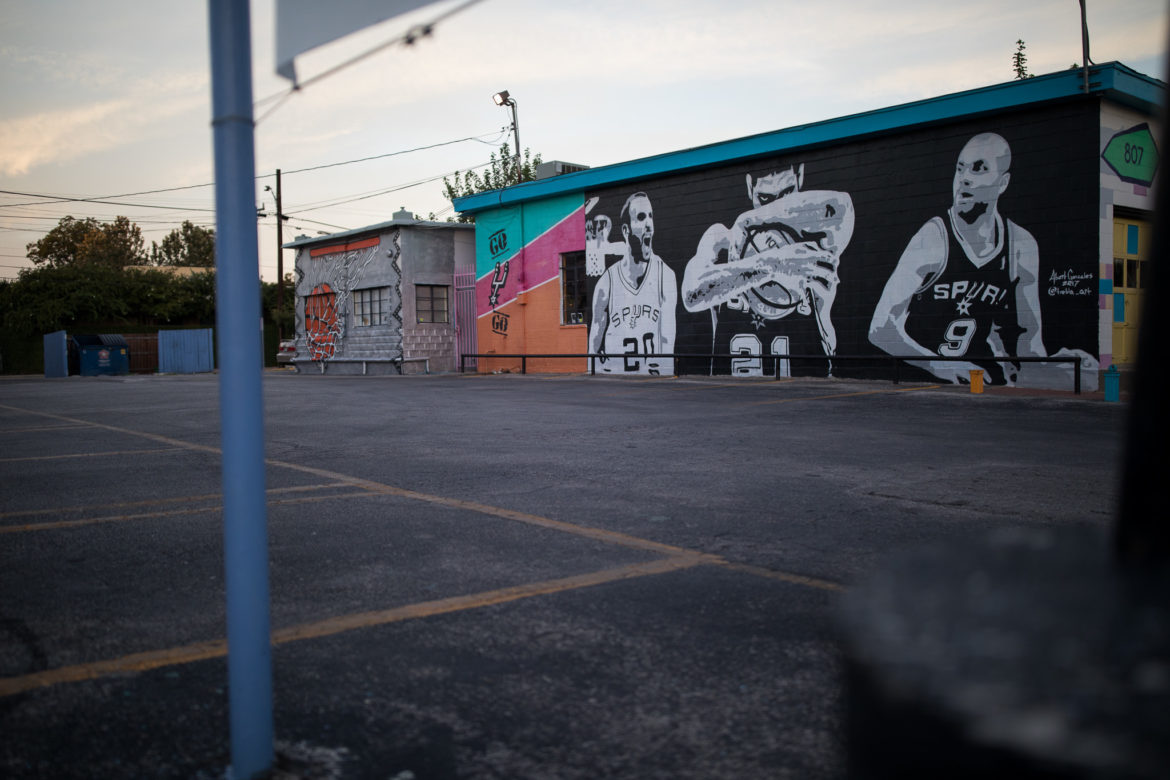A mural by Albert Gonzales depicts 'the big three' Manu Ginobili, Tim Duncan, and Tony Parker.