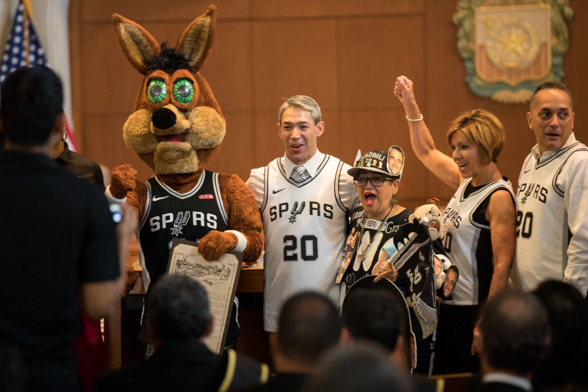 City staff and officials celebrate the proclamation by chanting 'Go Spurs Go'.