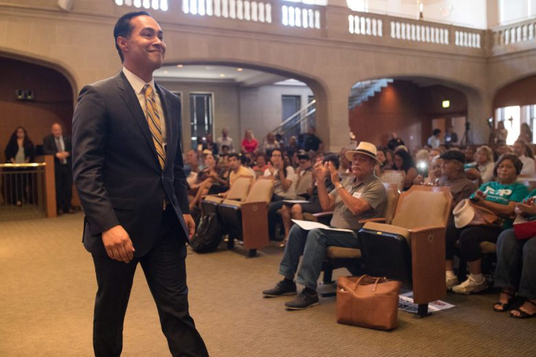 Former Secretary of Housing and Urban Development and former San Antonio Mayor Julian Castro is applauded by supporters of the paid sick leave ordinance following his speech to City Council.