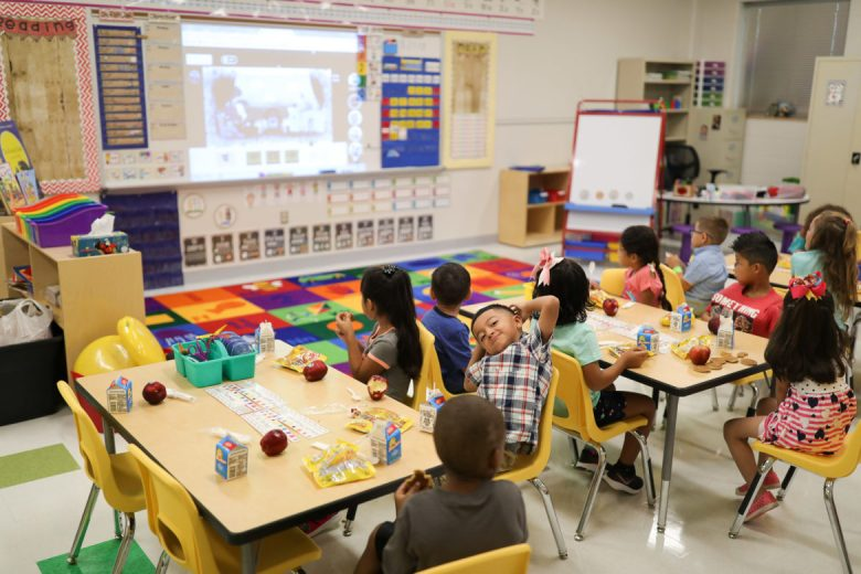 Students attend their first day of school at Menchaca Early Childhood Center.