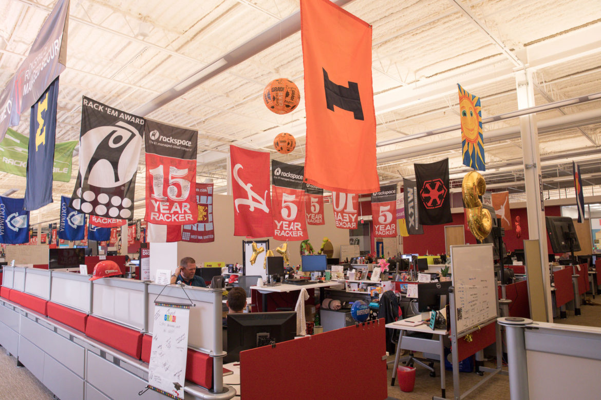 """Rackspace employees, or""""'rackers,"""" hang flags above their workstations at the tech company's headquarters."""