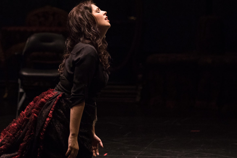 Violetta, performed by Amanda Woodbury, kneels during a rehearsal for Verdi's La Traviata.