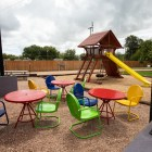 A playground is next to the outside seating area at StreetFare SA.