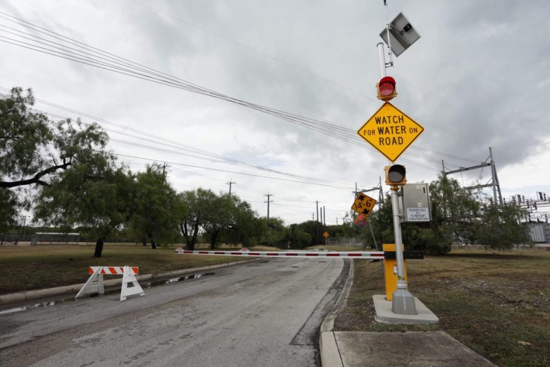 A closed street near the intersection of McCollough and Contour warns drivers about high water levels and the chance of flash floods.