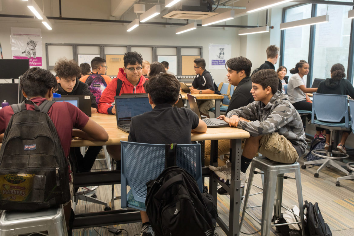 Students in a computer science class work on projects at CAST Tech.