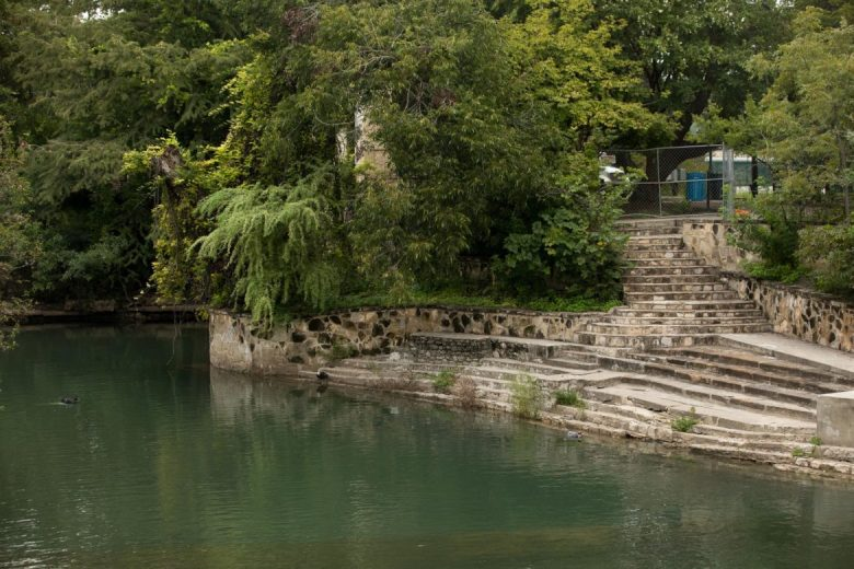 Steps leading from the historic pump house to the San Antonio River at Brackenridge Park.