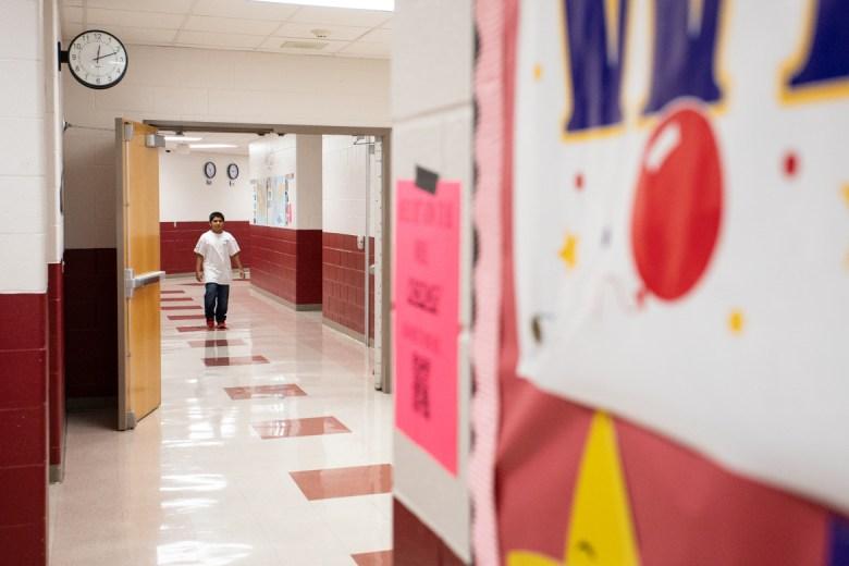 A student walks through Harris Academy.