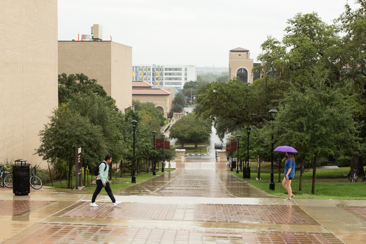 Students walk through the Texas State University campus.